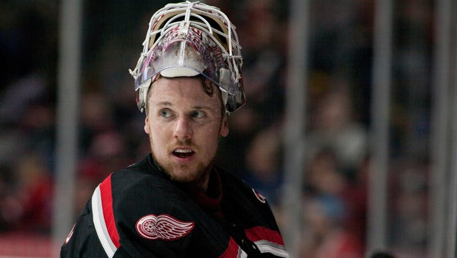 Jimmy Howard, playing goalie for the Grand Rapids Griffins, pauses during a time-out in the team's AHL hockey game against the Milwaukee Admirals on Saturday, Feb. 4, 2017 in Grand Rapids.
