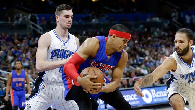 Pistons forward Tobias Harris protects the ball from the Magic's Mario Hezonja, left, and Evan Fournier during the first half Wednesday, April 12, 2017, in Orlando.