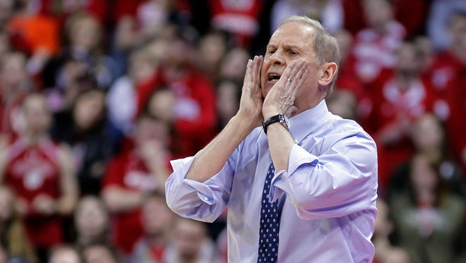 John Beilein yells to his team during the second half of Michigan's 83-72 win over Wisconsin on Sunday.