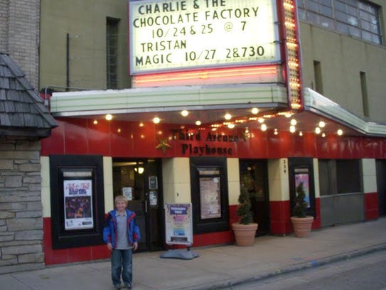 Isaiah Spetz poses outside Third Avenue Playhouse in