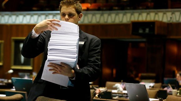 House Page Micah Palich hands out budget amendments