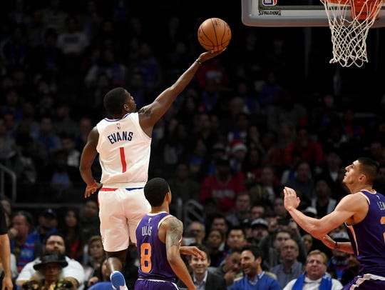Clippers guard Jawun Evans drives to the basket past Suns guard Tyler Ulis during a game last season
