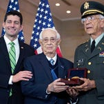 Col. Manuel Siverio, right, and Sgt. Maj. Jose Colon, members of the Army's 65th Infantry Borinquereers, received the Congressional Gold Medal from Speaker of the House Paul Ryan, left,  during a ceremony in Emancipation Hall of the Capitol Visitors Center in Washington, D.C, on April 13, 2016.