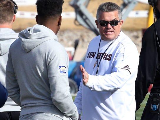 Arizona State head football coach Todd Graham, right,