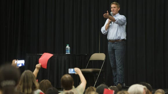 Sen. Jeff Flake answers questions during a town hall