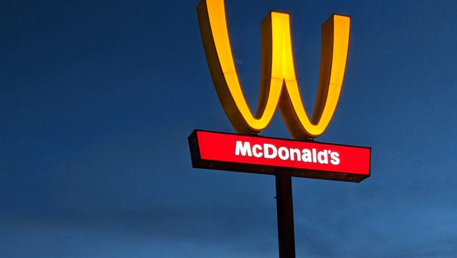 The Golden Arches sign outside the McDonald's restaurant Patricia Williams owns in Lynwood, Calif., is upside down in honor of International Women's Day on Thursday.
