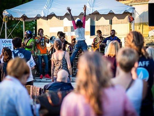 Lakou Mizik, a Haitian band, performs Tuesday at the Community Sailing Center.