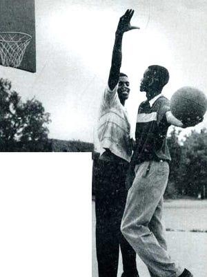 Cleveland Harp and Willie Gardner play around at the Lockefield Gardens Dust Bowl.
