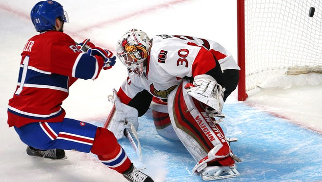 Montreal Canadiens center Lars Eller (81) scores a goal against Ottawa Senators goalie Andrew Hammond (30) during the second period in the game one of the first round of the 2015 Stanley Cup Playoffs at Bell Centre.