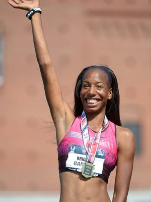 Brigetta Barrett celebrates after winning the women's high jump at the 2013 USA Championships at Drake Stadium in Des Moines.