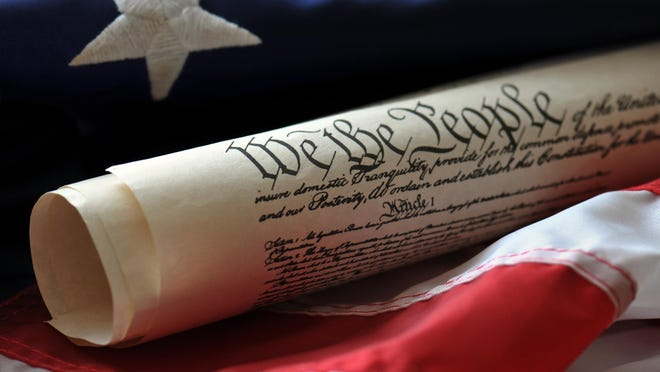 Getty Images/iStockphoto Today we celebrate Constitution Day and its importance. US Constitution document atop a US flag.
