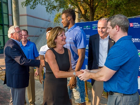 Mike and Karen Hartley greet FGCU coaches, players and administrators during the Alico Arena expansion groundbreaking Nov. 4, 2016.