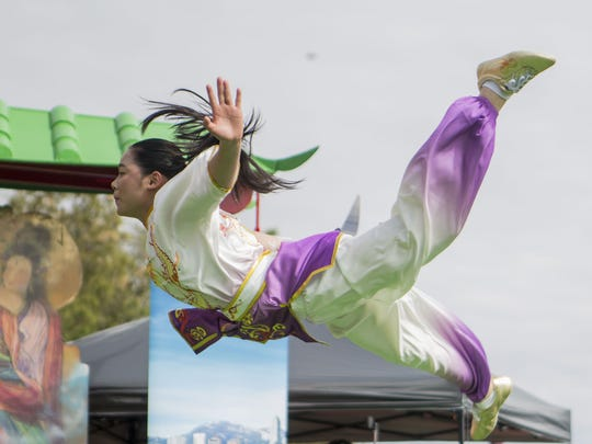 A performer from the World Martial Arts Academy performs at the annual Phoenix Chinese Week Chinese Culture and Cuisine Festival at Margaret T. Hance Park in Phoenix on Sunday, Feb. 18, 2018.
