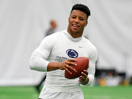 Penn State running back Saquon Barkley (26) catches a football during Penn State Pro Day in State College, Pa., Tuesday, March 20, 2018. Barkley did not participate in the drills. (AP Photo/Gene J. Puskar)