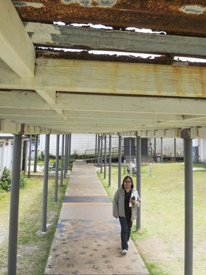 Principal Carla Masnayon walks under a wood and tin canopy near the science classes at Simon Sanchez High School in Yigo on Wednesday, May 11.
