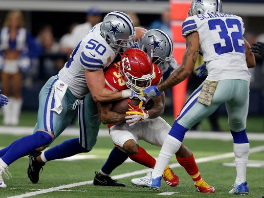 Dallas Cowboys' Sean Lee (50), Byron Jones, rear, and Orlando Scandrick (32) combine to stop Kansas City Chiefs' Charcandrick West (35) after a short run in the first half of an NFL football game, Sunday, Nov. 5, 2017, in Arlington.