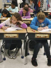 In this 2013 file photo students in a fifth grade English Language Arts class at Margaret L. Vetter Elementary School in Eatontown, participate in a writer's workshop.