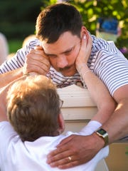 Brooke's father, James Bennett, is comforted during a vigil in Randolph in July 2008.