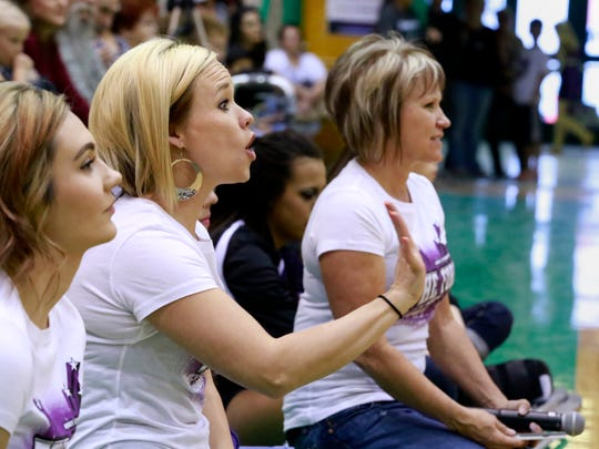 From left, The Force coaches Kelsey Emery, Crista Farmer and Sheila Mobley watch their students perform on April 28 at the dance studio's annual showcase at Farmington High School.