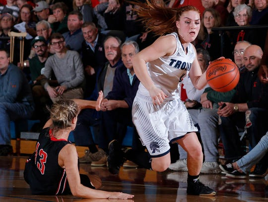 East Lansing's Taryn McCutcheon, right, drives and