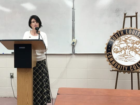South Louisiana Community College Chancellor Natalie Harder talks Tuesday about an agreement connecting the college's application software development program with UL Lafayette's informatics program.