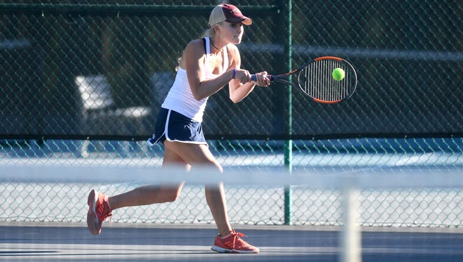 Asheville School's Sarah Abernethy returns a ball during a doubles match against St. Joseph's Catholic School on Wednesday, Oct. 4, 2017.