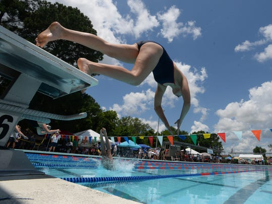 Taylor Stone of COSST leaps into the pool from the starting blocks as she swims the Girls' 200M Breast at Saturday's Calumet Specialty Products Damon McCoy Swim Invitational.