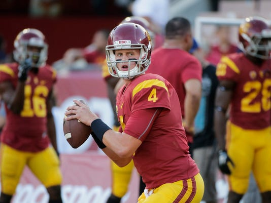 FILE - In this Oct. 8, 2015, file photo, Southern California quarterback Max Browne warms up before an NCAA college football game against Washington, in Los Angeles. Max Browne insists he wouldn't want slightly less daunting circumstances for his long-awaited debut as No. 20 Southern California's starting quarterback. His first shot finally comes Saturday against top-ranked Alabama in the Dallas Cowboys' massive stadium. (AP Photo/Jae C. Hong, File)
