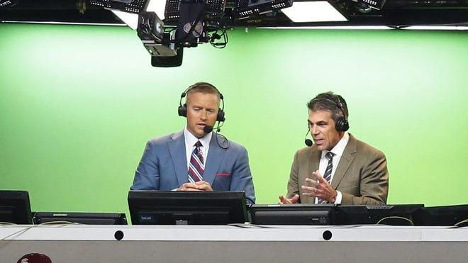 ESPN broadcasters Kirk Herbstreit, left, and Chris Fowler announce a college football game between Florida State and Oklahoma State at AT&T Stadium in Arlington, Texas, on Aug. 30, 2014. The pair, who have worked together for several seasons calling college football games, will make their NFL broadcasting debut by calling the first Monday Night Football game of the season on Sept. 14 between the Pittsburgh Steelers and the New York Giants, ESPN announced on Monday.