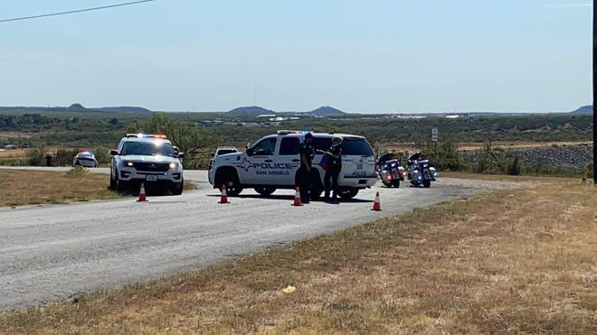 San Angelo police block off Mercedes Road near O.C. Fisher dam during a chase in progress around 4:30 p.m., Wednesday, August 5th, 2020. Photo by Colin Murphey, San Angelo Standard Times.