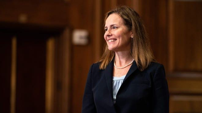 Judge Amy Coney Barrett, President Donald Trumps nominee for Supreme Court, smiles for a photo with Senator David Perdue, R-GA at the US Capitol on September 30, 2020, in Washington, DC.Anna Moneymaker, Pool