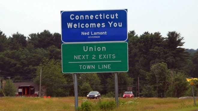 Ganley Images  A photo of a sign welcoming travelers from Massachusetts into the state of Connecticut on Interstate 84.