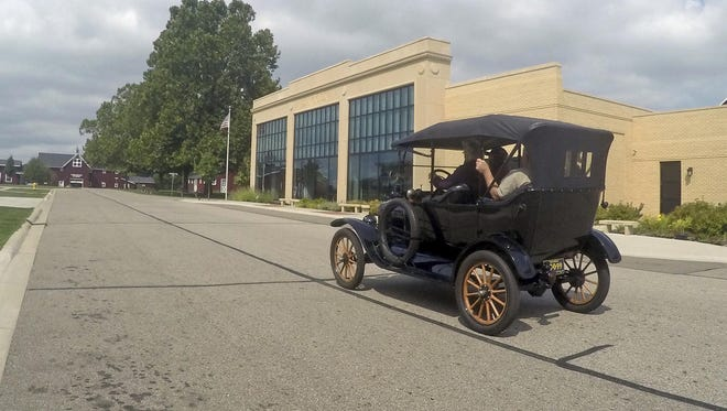 A student driver operates a Model T on the grounds of the Gilmore Car Museum in Hickory Corners in August.