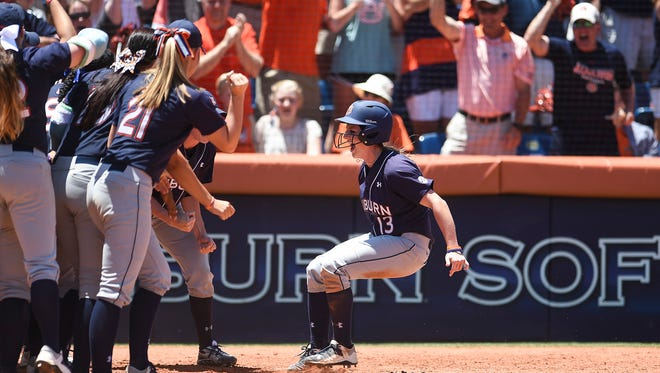 Auburn third baseman Kasey Cooper celebrates after her three-run home run against Louisiana-Lafayette on Saturday,