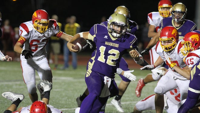 Norwalk junior quarterback Brady Brandsfield carries the ball for Norwalk's winning score against Carlisle. Norwalk hosted Carlisle in their Homecoming game Sept. 11, winning 23-16 with a touchdown in the final minute.