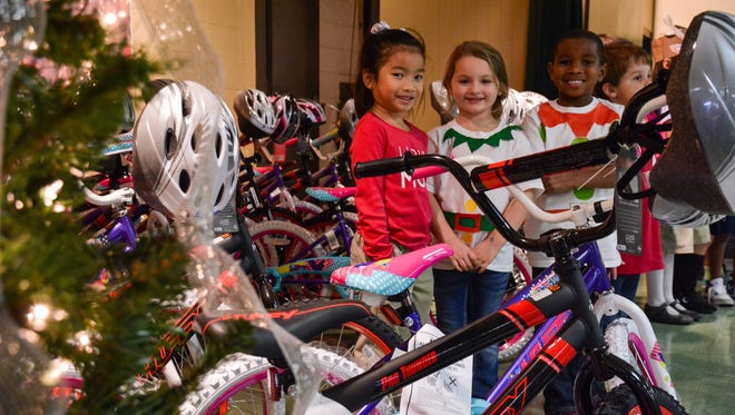 Academy donated 30 bikes and helmets to students at S.J. Montgomery Elementary who had good behavior.