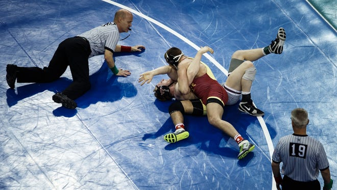Iowa State's Patrick Downey pins Virginia Tech's Jared Haught during the 2016 NCAA championships in New York.