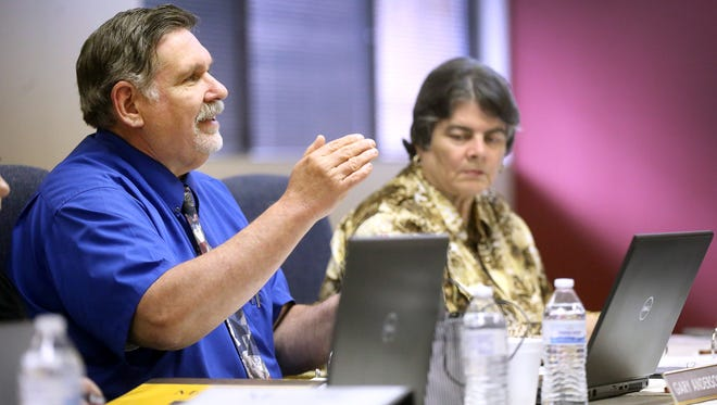 Gary Anderson, director of finance and administration for Murfreesboro City Schools, goes over the proposed budget for next school year with members of the school board during a meeting Tuesday, April 19, 2016.