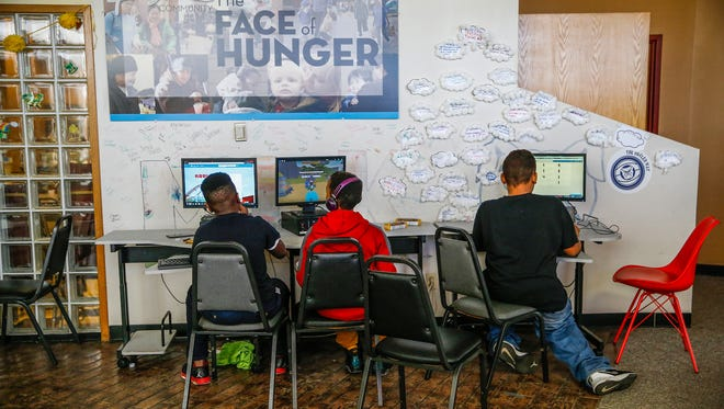 From left, Dameon Anderson, 12, Tajahn Davidson, 12, and Damon Lee, 11, play Roblox at the Martin Luther King Center on Wednesday, March 22, 2017. Students are on spring break this week so the center keeps the kids busy. Most are watching a movie, a few are being tutored by parents' request, others are playing on computers. After lunch, the children will head to the batting cages.