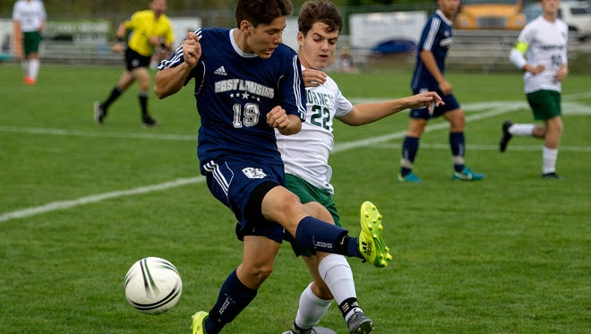 East Lansing's Robert Nystrom, left, and Williamston's Luciano Stornant battle for ball control during the first half on Tuesday, Sept. 3, 2017, in Williamston.
