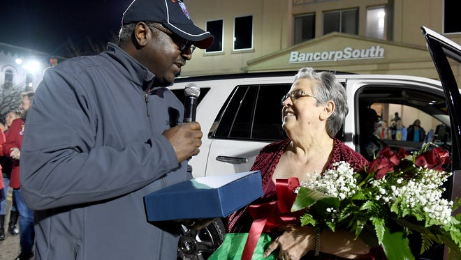 Executive Director of Jackson Recreation & Parks Tony Black presents roses and a plaque to Shirley Jones as the Grand Marshall of the 2017 City of Jackson Christmas Parade, Monday, Dec. 4.