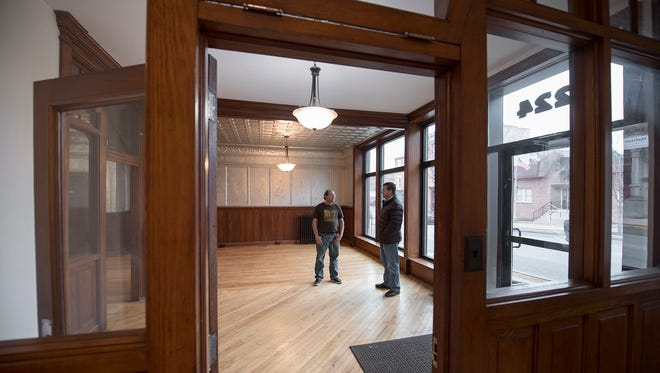 Mike Knaub president of Starview Brews, left, and Don Murphy, owner of the building chat in a front room of the building that will house Starview Brews at 224 Locust Street in Columbia.