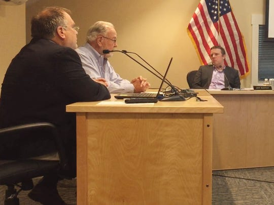 From left, Burlington International Airport Director of Aviation Gene Richards and Airport Commission chairman Jeff Munger speak to members of the Colchester Selectboard at Colchester's town offices on Tuesday, Aug. 22, 2017.