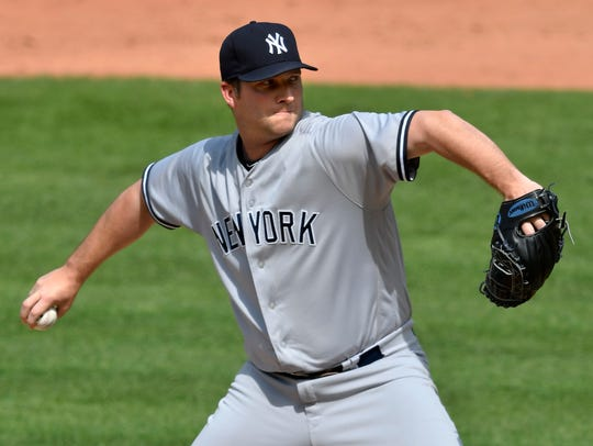 New York Yankees relief pitcher Adam Warren (43) delivers