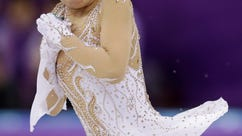 Karen Chen of the United States performs during the women's short program figure skating in the Gangneung Ice Arena at the 2018 Winter Olympics in Gangneung, South Korea, Wednesday, Feb. 21, 2018. (AP Photo/Bernat Armangue)