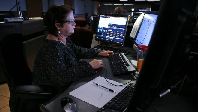 MetroSafe dispatcher Cindy Hedges works a call at MetroSafe headquarters downtown. New enhancements to the emergency notification system will allow individuals and families to sign up online to receive emergency notifications such as severe weather alerts and provide information to 9-1-1 in case of an emergency.