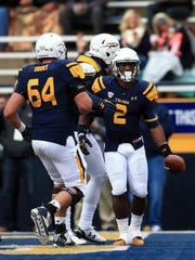 Toledo running back Terry Swanson celebrates with offensive