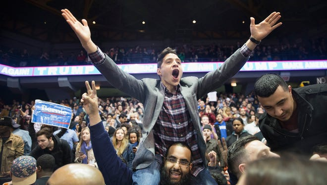 Demonstrators celebrate after it was announced that a rally with Republican presidential candidate Donald Trump at the University of Illinois at Chicago would be postponed on March 11, 2016.
