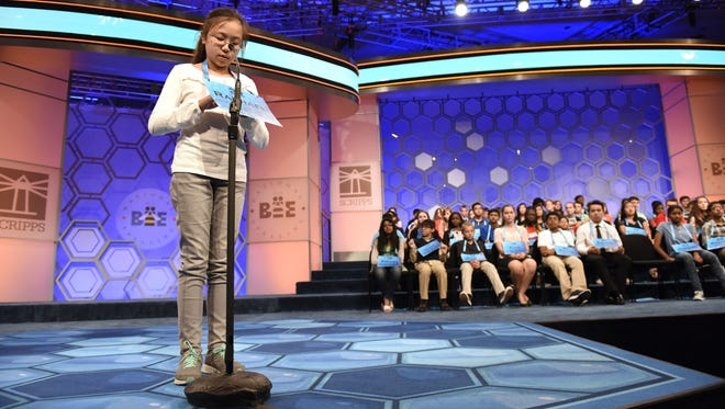 """Raphael Kim, 12, of Newark, correctly spells """"Moroccan"""" in round three during the 2016 Scripps National Spelling Bee at the Gaylord National Resort and Convention Center."""