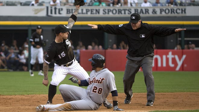 Detroit Tigers right fielder J.D. Martinez (28) makes it to second base before Chicago White Sox second baseman Brett Lawrie (15) can tag him out during the second inning on Monday, June 13, 2016, at U.S. Cellular Field in Chicago. (Erin Hooley/Chicago Tribune/TNS)